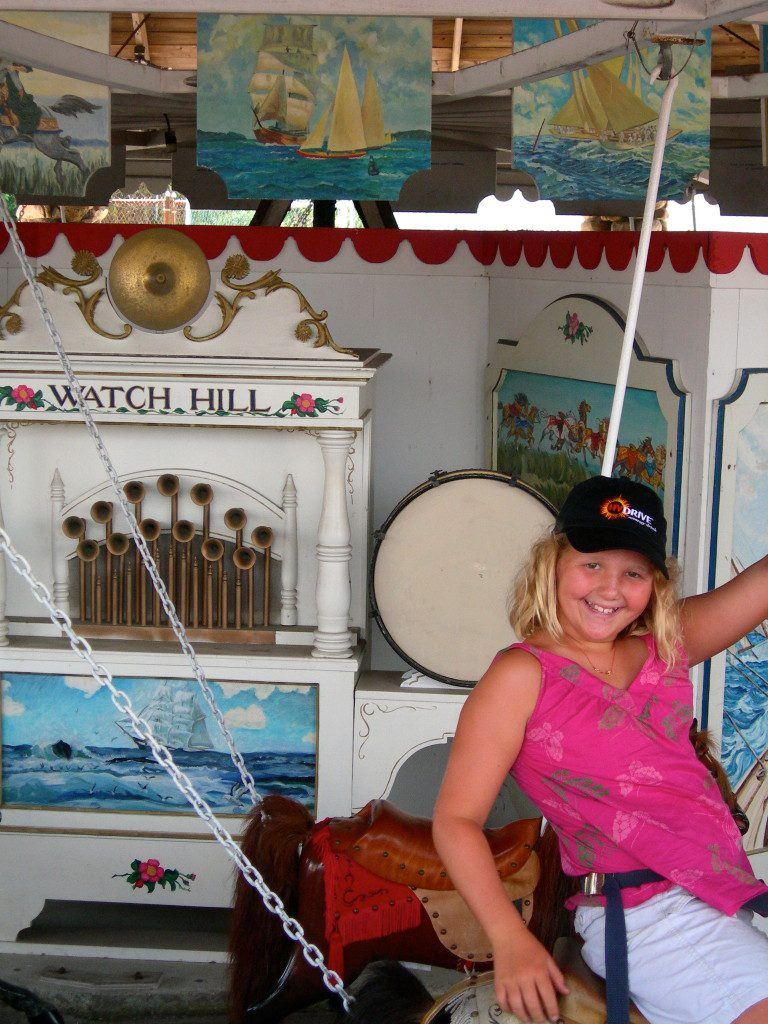 Grace, age 10, on the Merry-Go-Round